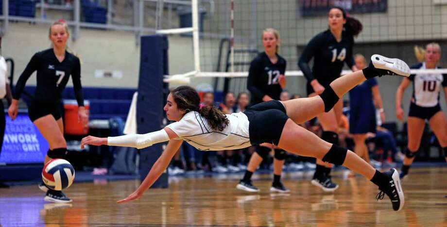 Clark Madison Cuellar dives for the ball from the District 28-6A high school volleyball showdown between No. 2 Clark and No. 5 Brandeis on Tuesday, October 9, 2019. Clark defeated Brandeis 3-1. Photo: Ronald Cortes/Contributor / 2019 Ronald Cortes