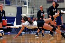 Clark Madison Cuellar dives for the ball from the District 28-6A high school volleyball showdown between No. 2 Clark and No. 5 Brandeis on Tuesday, October 9, 2019. Clark defeated Brandeis 3-1.