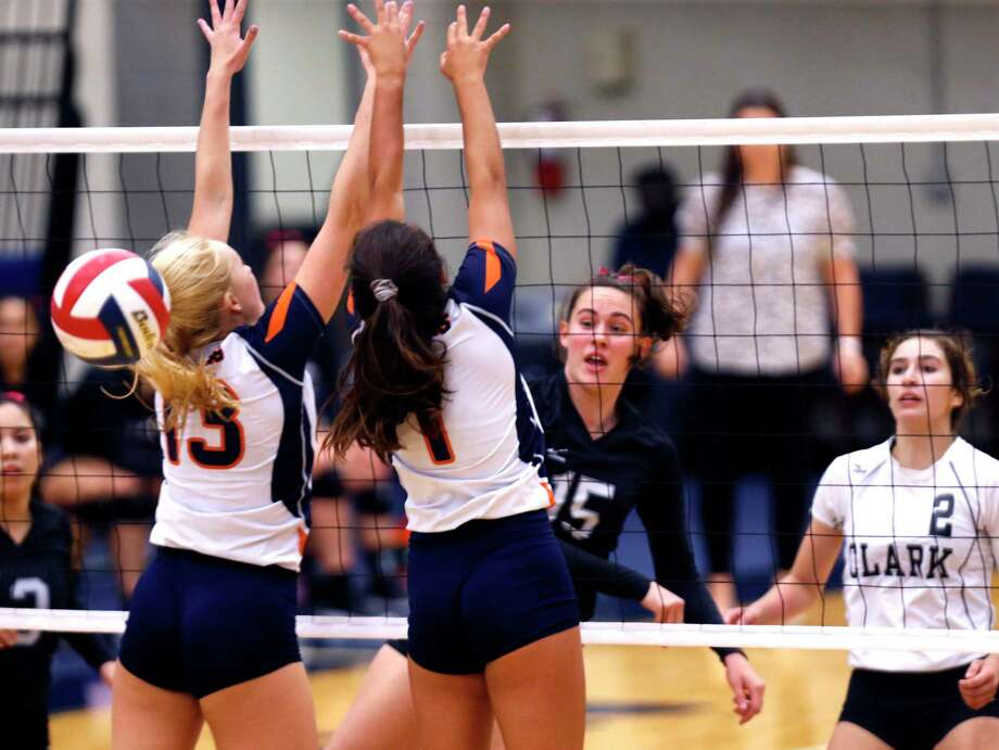Clark Grace Gibson slams the ball past Brandeis Ava Magnabosco,13, and Emilia Guerra-Acuna from the District 28-6A high school volleyball showdown between No. 2 Clark and No. 5 Brandeis on Tuesday, October 9, 2019. Clark defeated Brandeis 3-1. Photo: Ronald Cortes/Contributor / 2019 Ronald Cortes