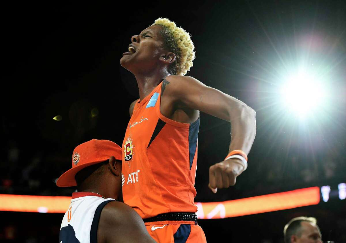Connecticut Sun's Courtney Williams gets a lift from her father Don Williams after the Sun defeated the Washington Mystics in Game 4 of basketball's WNBA Finals, Tuesday, Oct. 8, 2019, in Uncasville, Conn. (AP Photo/Jessica Hill)