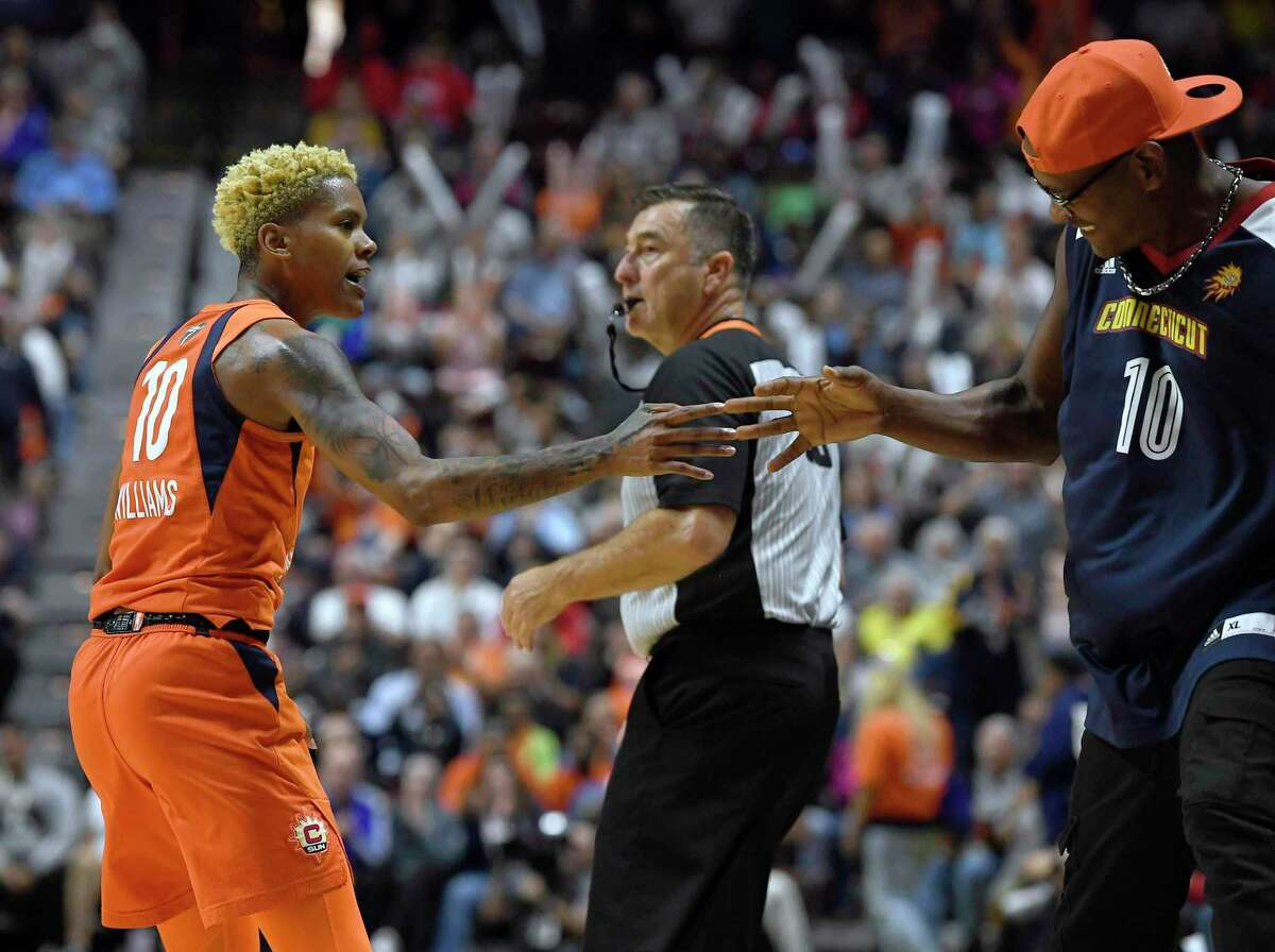 Connecticut Sun's Courtney Williams celebrates with her father Don Williams during the first half in Game 4 of basketball's WNBA Finals against the Washington Mystics, Tuesday, Oct. 8, 2019, in Uncasville, Conn. (AP Photo/Jessica Hill)