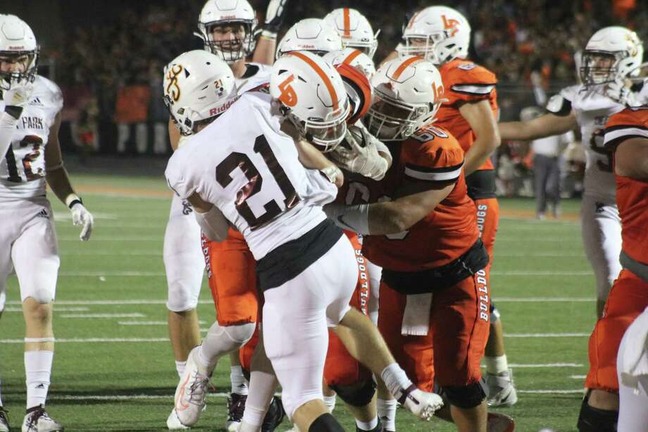 It was a win-win situation for Deer Park's defense and La Porte's offense after their game last week. Deer Park's defense, represented by Zach Frazee (21), lowered its average and La Porte's offense raised its average. Photo: Robert Avery