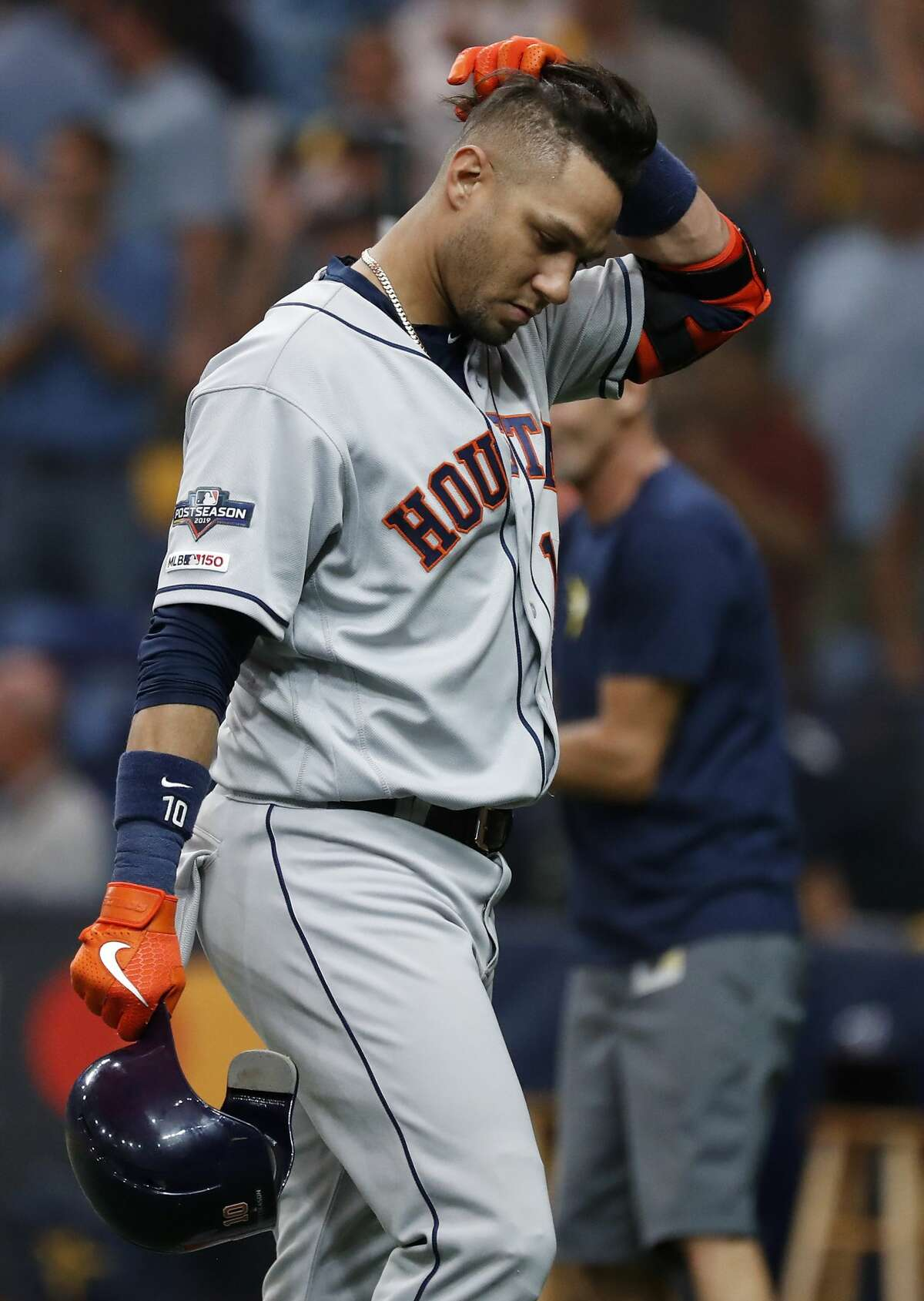 Houston Astros first baseman Yuli Gurriel walks off the field after grounding out to Tampa Bay Rays third baseman Joey Wendle to end Game 4 of the American League Division Series at Tropicana Field on Tuesday, Oct. 8, 2019, in St. Petersburg, Fla. The Rays beat the Astros 4-1 to even the best-of-five series at 2-2.