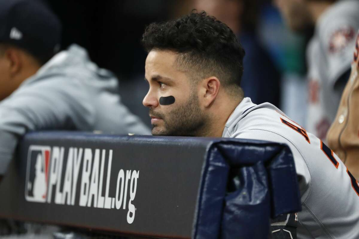Houston Astros second baseman Jose Altuve stands at the end of the dugout during of Game 4 of the American League Division Series against the Tampa Bay Rays at Tropicana Field on Tuesday, Oct. 8, 2019, in St. Petersburg, Fla.