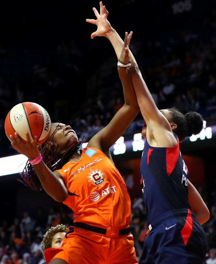 Mystics guard Aerial Powers (right) contests a shot from Jonquel Jones, who led the Sun with 18 points. Photo: Maddie Meyer / Getty Images