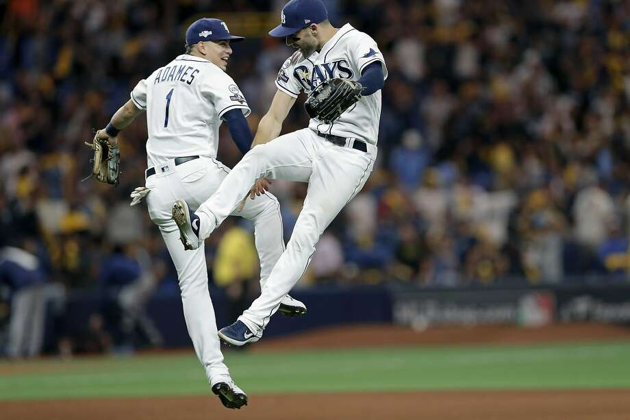 Tampa Bay shortstop Willy Adames (left) and center fielder Kevin Kiermaier celebrate the Rays' 4-1 win over Houston. Photo: Chris O'Meara / Associated Press