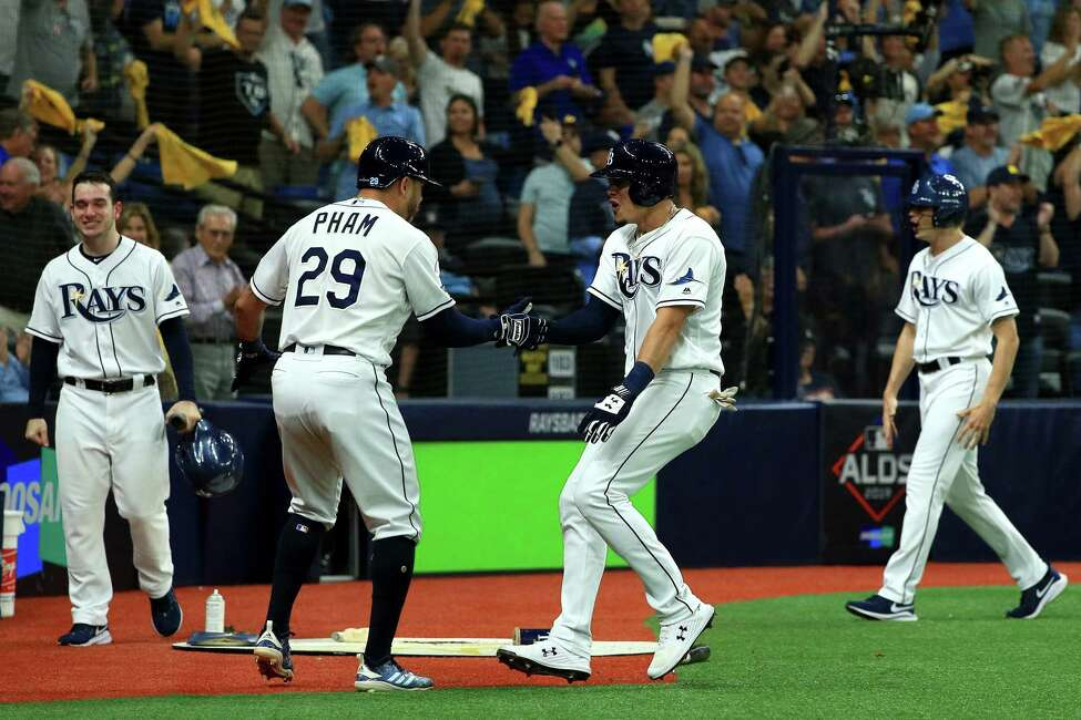 ST PETERSBURG, FLORIDA - OCTOBER 08: Willy Adames #1 of the Tampa Bay Rays is congratulated by his teammates after hitting a solo home run against the Houston Astros during the fourth inning in game four of the American League Division Series at Tropicana Field on October 08, 2019 in St Petersburg, Florida. (Photo by Mike Ehrmann/Getty Images)