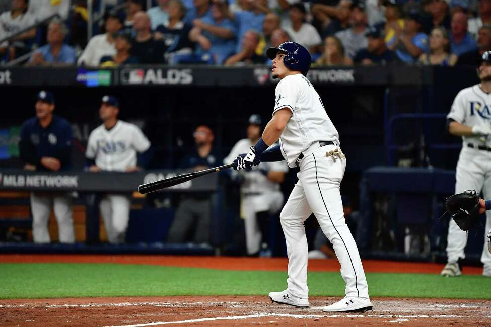 ST PETERSBURG, FLORIDA - OCTOBER 08: Willy Adames #1 of the Tampa Bay Rays hits a home run against the Houston Astros during the fourth inning in game four of the American League Division Series at Tropicana Field on October 08, 2019 in St Petersburg, Florida. (Photo by Julio Aguilar/Getty Images)