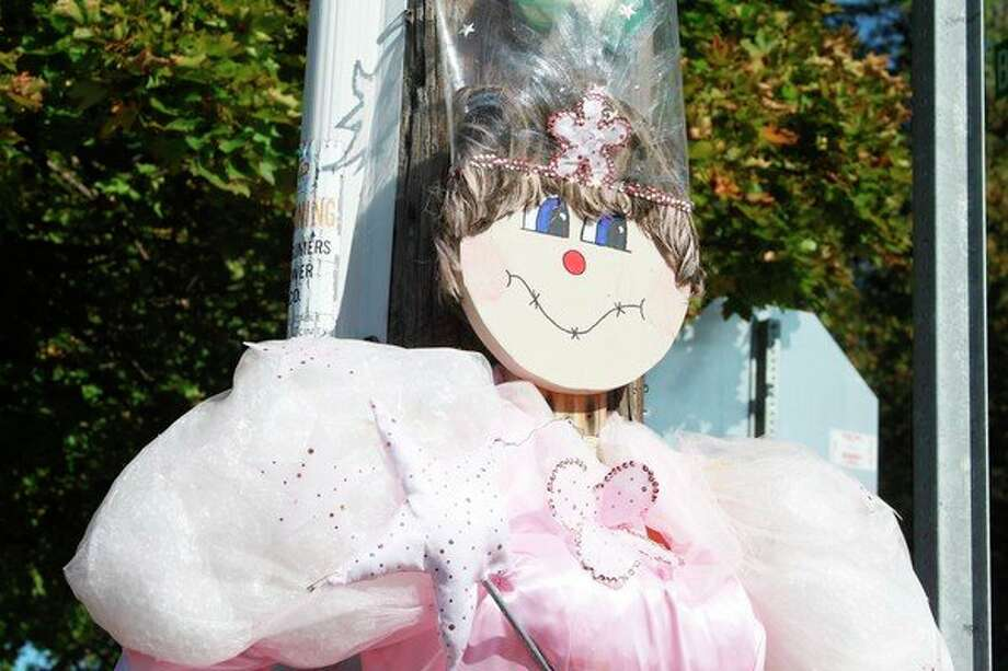 """A """"princess"""" scarecrow hangs around downtown Onekama as part of a contest being held for the annual fall festival on Saturday. (Ashlyn Korienek/News Advocate)"""