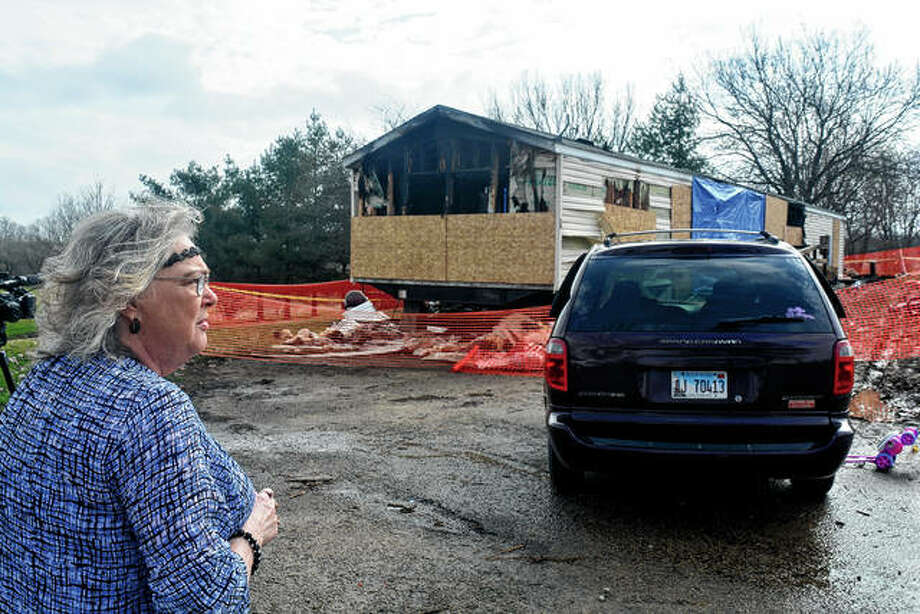 Marie Chockley, a resident of Timberline Trailer Court, north of Goodfield, surveys in April the damage that was caused by a fire that killed five residents in a mobile home. A prosecutor says a central Illinois 9-year-old will face five counts of first-degree murder in connection with the deadly mobile home fire. Photo: Kevin Barlow | The Pantagraph Via AP
