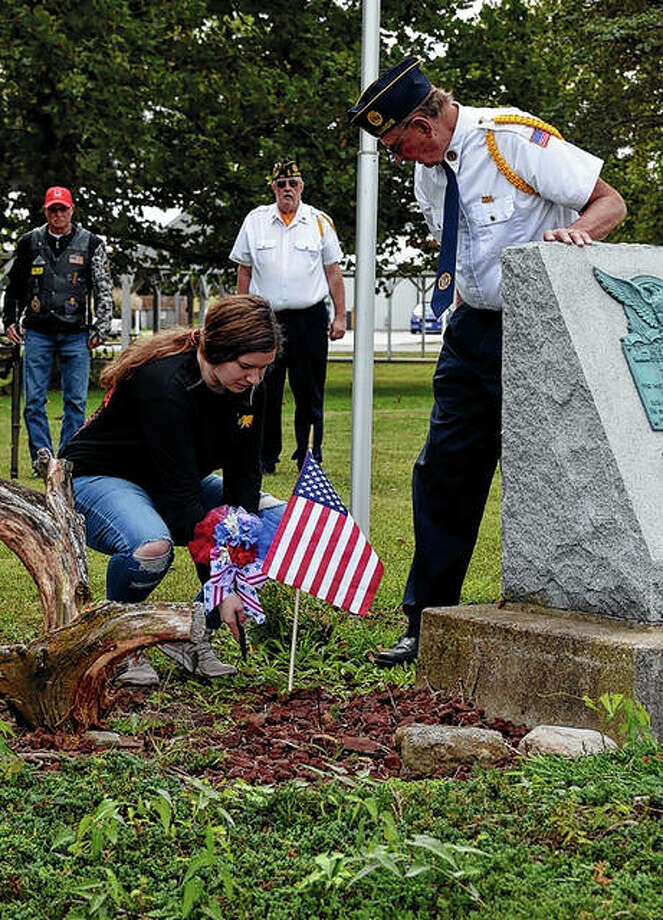 Veteran Jim Launer (right) and Palmyra resident Kailey Fagg honor veterans. Photo: Kathleen Clark | Journal-Courier