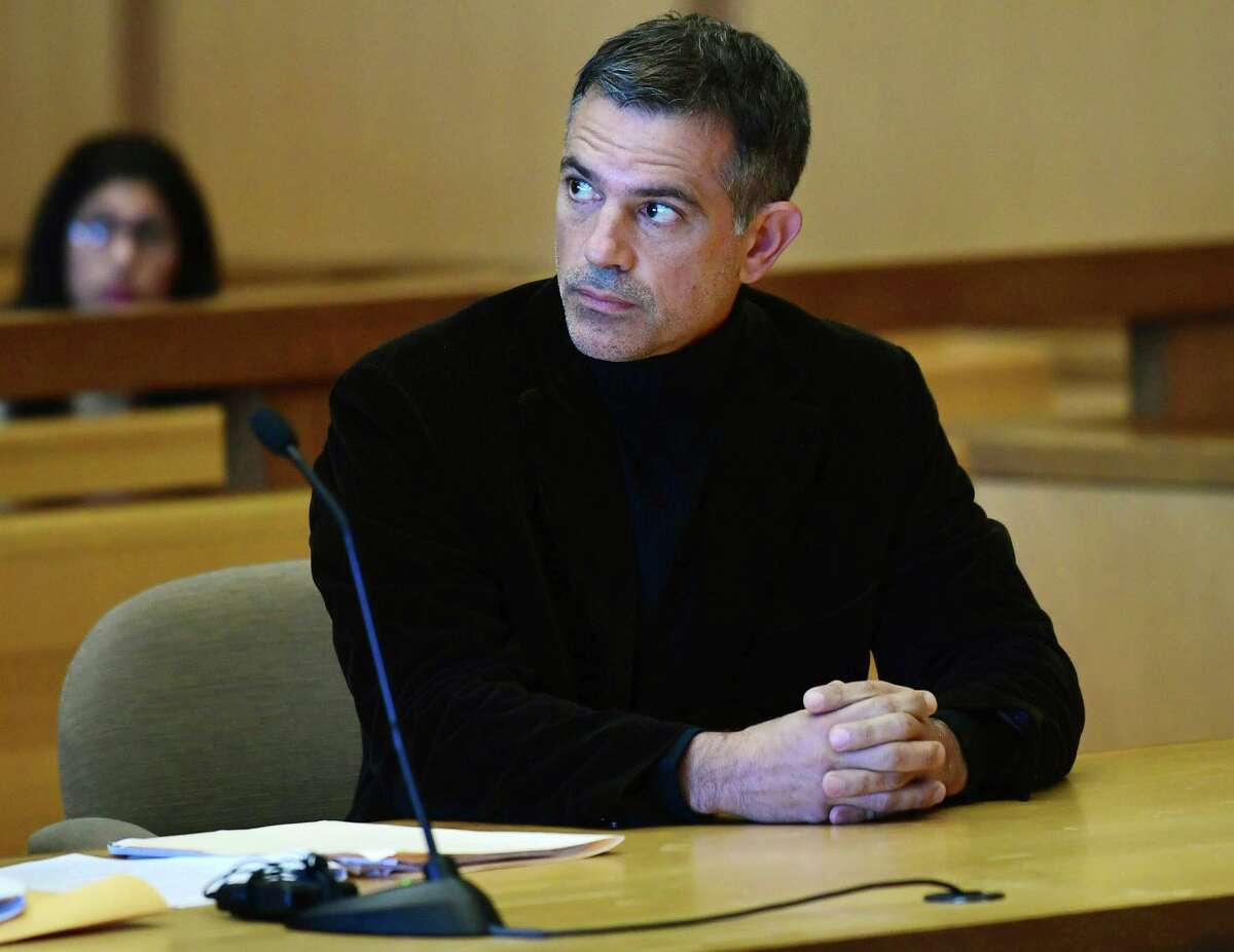Fotis Dulos, charged with two counts of tampering with evidence and hindering prosecution in the disappearance of his wife, appears with his attorney Kevin Smith at Stamford Superior Court for a pre-trial hearing Friday, Oct. 4, 2019, in Stamford, Conn. (Erik Trautmann/Hearst Connecticut Media via AP)