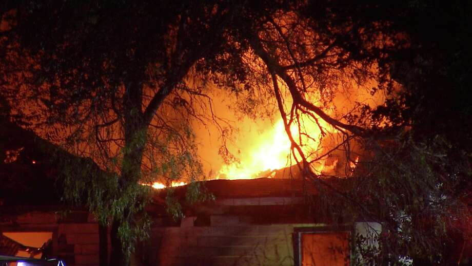 Bexar County Fire Marshall is investigating after a family home was destroyed in late night fire. Photo: Ken Branca