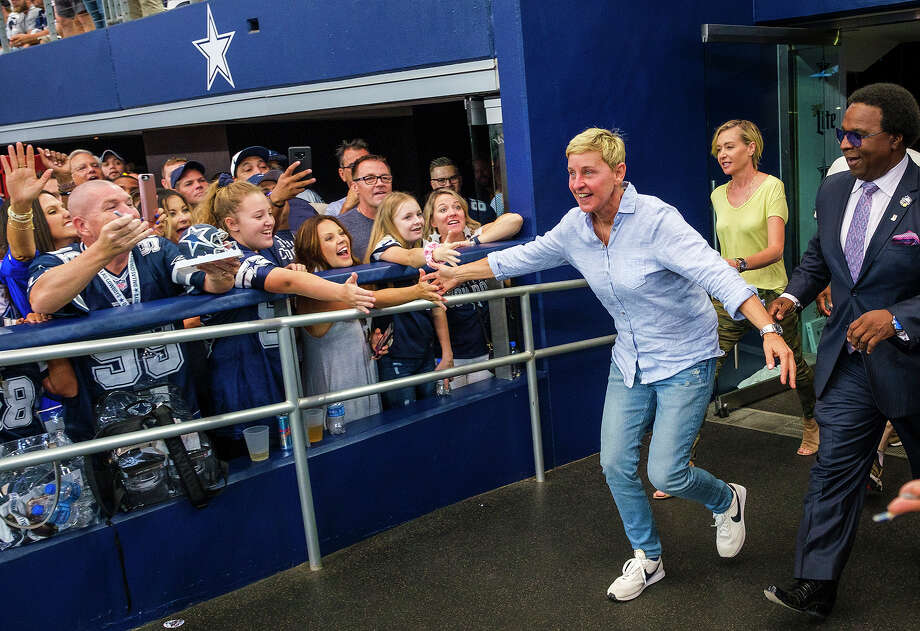 Ellen DeGeneres high-fives fans before an NFL football game between the Dallas Cowboys and the Green Bay Packers on Sunday at AT&T Stadium. Photo: Smiley N. Pool/The Dallas Morning News/TNS
