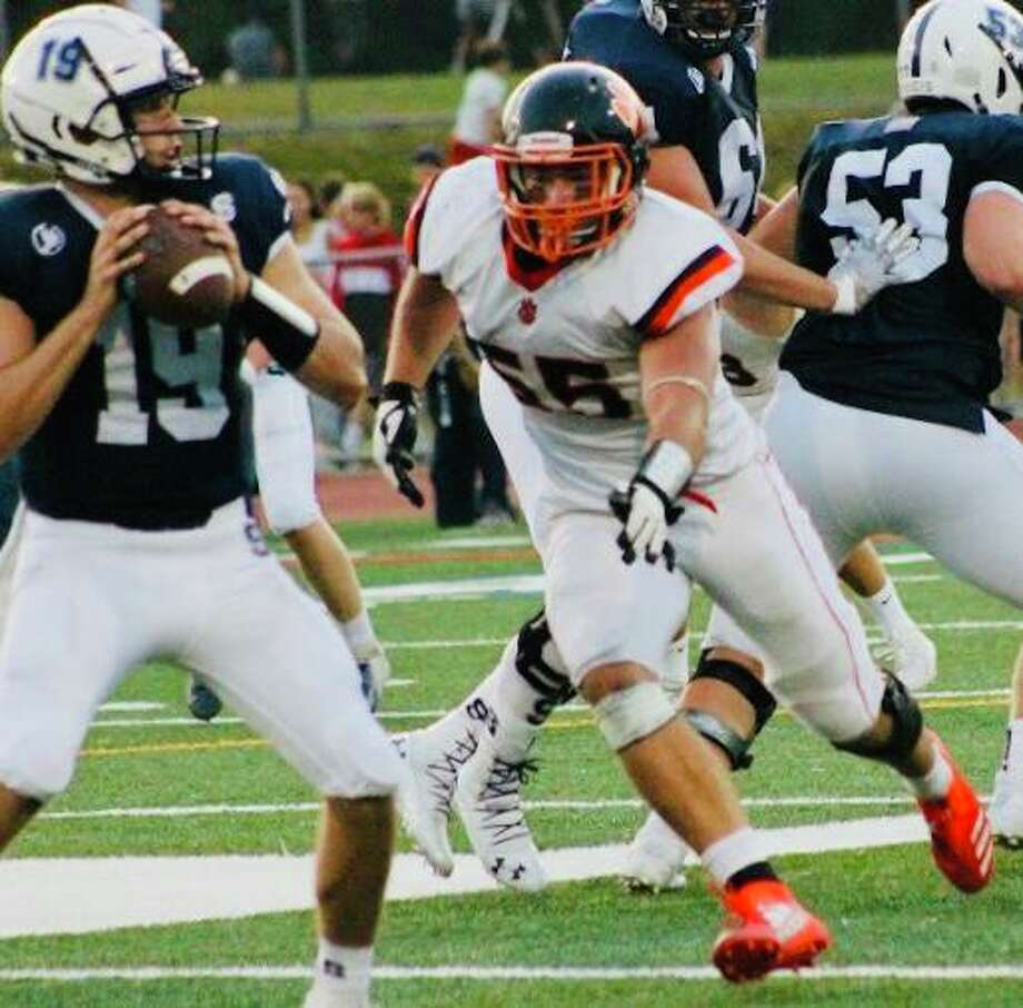 Ridgefield senior Reid Englert (55) has given a verbal commitment to play football at Columbia University. Photo: Contributed Photo / Ridgefield High Football