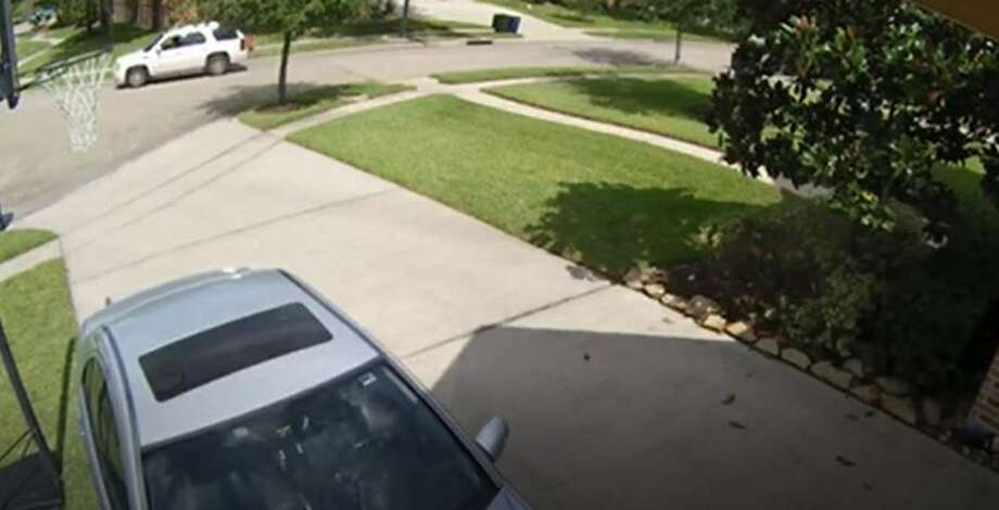 Police said the suspect was driving a white, 4-door SUV with dark tinted windows that was seen on a home surveillance video. Photo: City Of League City
