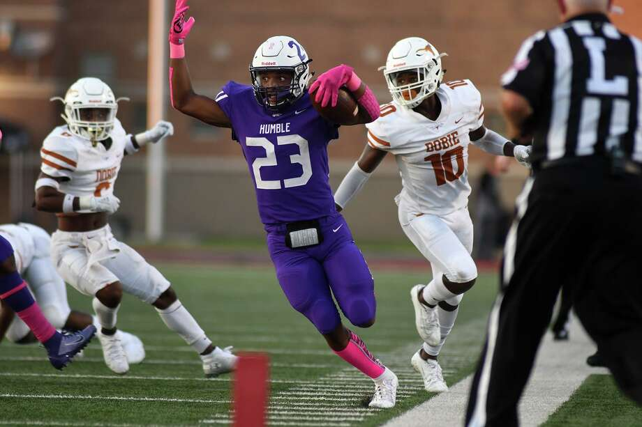 Humble senior wide receiver Dontee' McCray (23) tightropes the sideline ahead of Dobie defender Johnathan Baldwin (10) on a long gain in the second quarter of their District 22-6A matchup with Humble at Turner Stadium in Humble on Oct. 5, 2019. Photo: Jerry Baker, Houston Chronicle / Contributor / Houston Chronicle