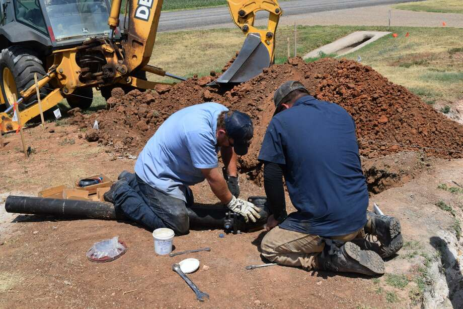 Silas Jones, owner of Thunder Well Service out of Shallowater, and Tyler Yardis, assistant driller, work to drill a well to help replenish the water supply in Halfway. Photo: Ellysa Harris/Plainview Herald