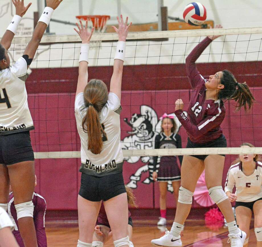 Tulia's Erika Salinas tries to hit the ball past Bushland defenders Addyson Tiffin (left) and Jaycee Adams during their District 1-3A volleyball match on Tuesday. Photo: Nathan Giese/Planview Herald