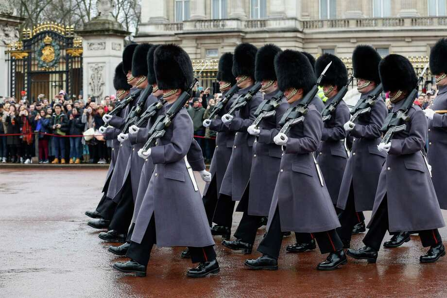 Coldstream Guards march after the performing the Changing the Guard ceremony at Buckingham Palace in London on March 3, 2017. Photo: Bloomberg Photo By Luke MacGregor. / © 2017 Bloomberg Finance LP
