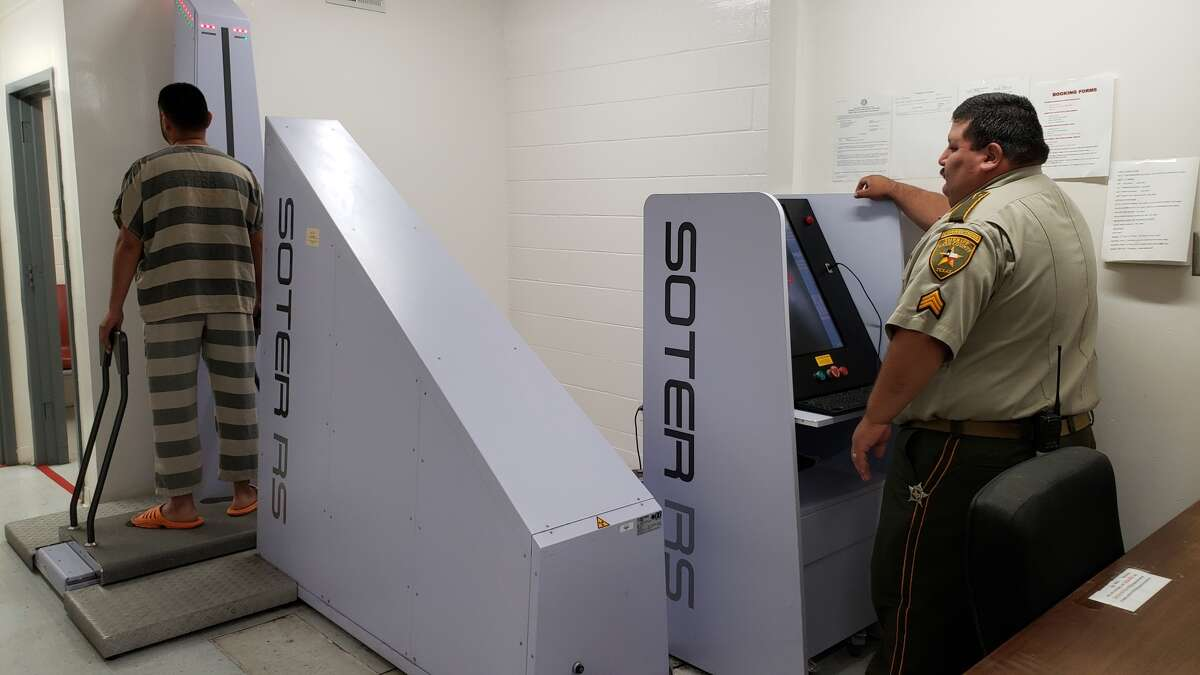 Sgt. Luis Ramos performs a full body X-ray scan on an incoming inmate at the Webb County Jail. Each inmate is scanned to keep contraband out of the jail. On Tuesday, the Webb County Sheriff's Office announced the arrest of 39 people who tried to smuggle narcotics into the jail.