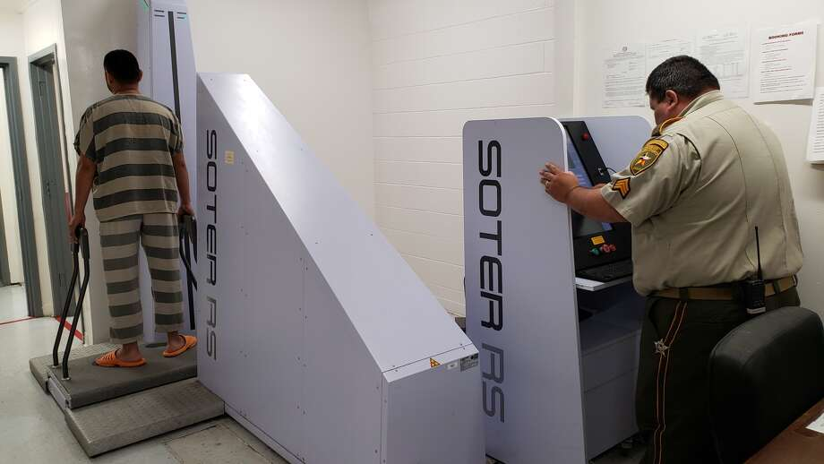 In this file photo, Sgt. Luis Ramos performs a full body X-ray scan on an incoming inmate at the Webb County Jail. Photo: Courtesy