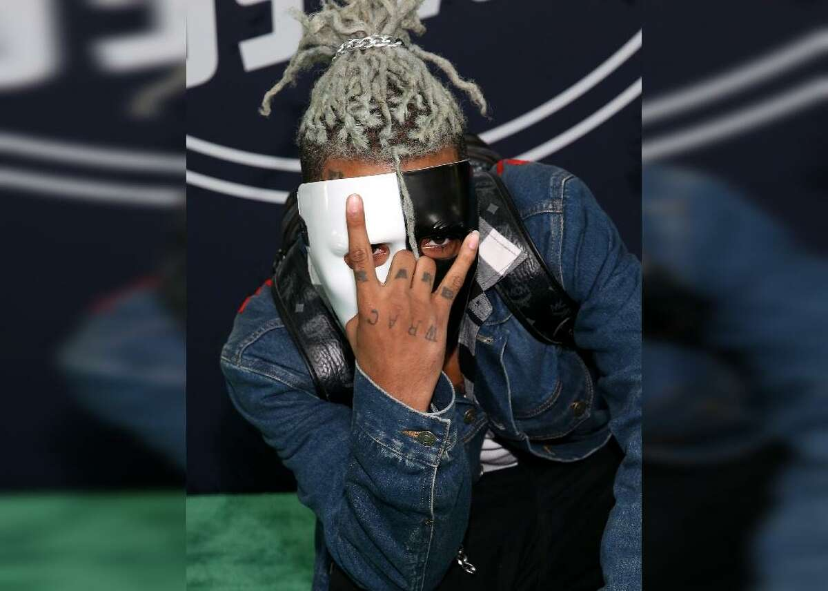 #39. XXXTenacion - Total earnings: $12,100,000 --- Sales: $695,000 --- Streaming: $9,100,000 --- Publishing: $2,370,000 --- Touring: $0 South Florida rapper Jahseh Dwayne Ricardo Onfroy, who adopted the professional moniker XXXTenacion, earned his musical chops upon the release of his album