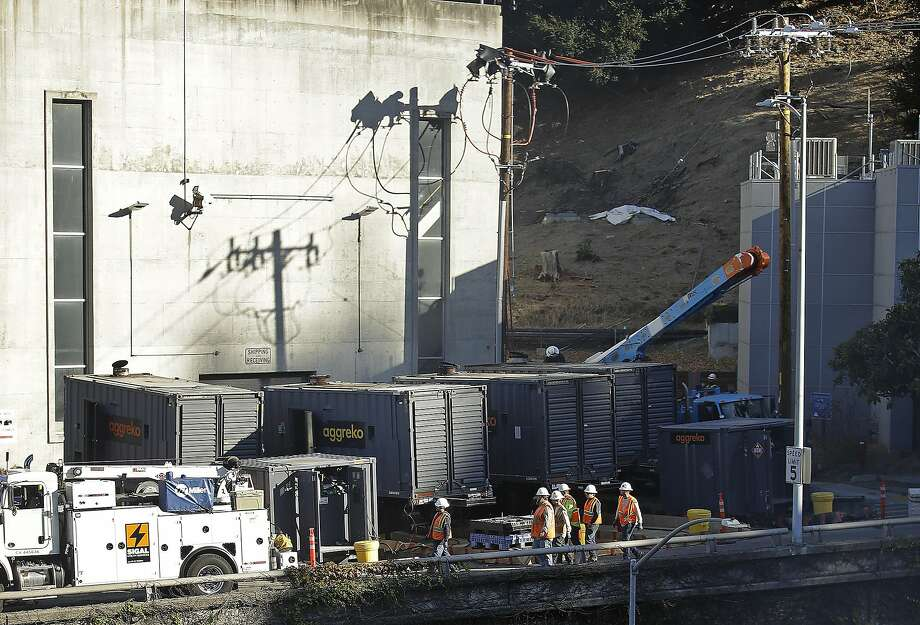 Crews work to connect generators in effort to keep the Caldecott Tunnel open to traffic during a possible power outage at noon on Wednesday, Oct. 9, 2019, in Oakland, Calif. Pacific Gas & Electric has cut power to more than half a million customers in Northern California hoping to prevent wildfires during dry, windy weather throughout the region. (AP Photo/Ben Margot) Photo: Ben Margot, Associated Press