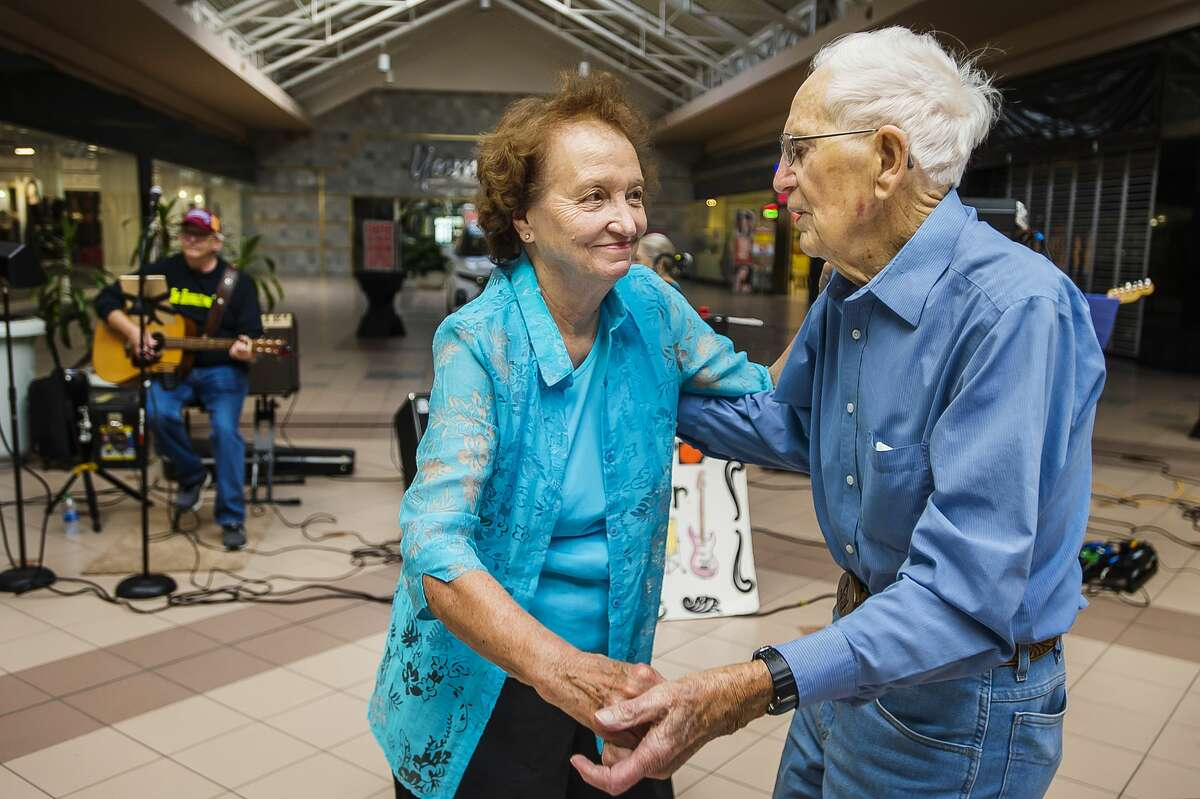 Sanford residents Mary Nielsen, left, and Duane Betz, right, dance together as a live band plays during the Midland Daily News Fall Senior Expo Wednesday, Oct. 9, 2019 at Midland Mall. (Katy Kildee/kkildee@mdn.net)