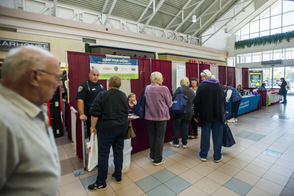 Visitors peruse booths representing local businesses and organizations at the Midland Daily News Fall Senior Expo Wednesday, Oct. 9, 2019 at Midland Mall. (Katy Kildee/kkildee@mdn.net)