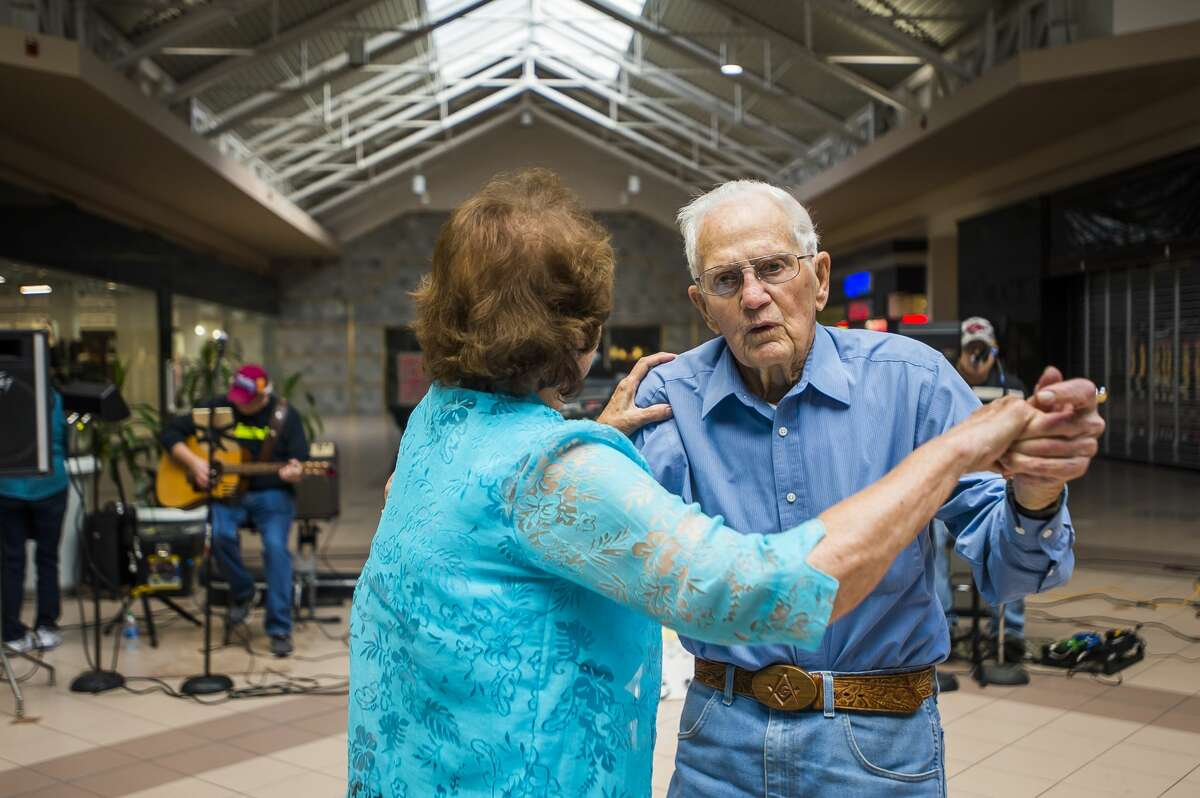 Sanford residents Duane Betz, right, and Mary Nielsen, left, dance together as a live band plays during the Midland Daily News Fall Senior Expo Wednesday, Oct. 9, 2019 at Midland Mall. (Katy Kildee/kkildee@mdn.net)