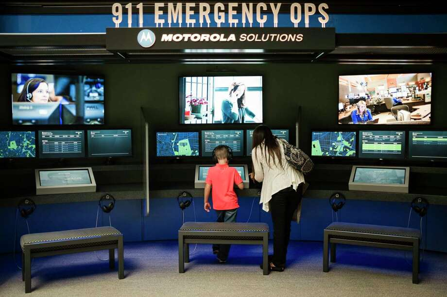 Visitors check out an exhibit at the National Law Enforcement Museum in Washington in October 2018. Photo: Photo For The Washington Post By J. Lawler Duggan / For The Washington Post