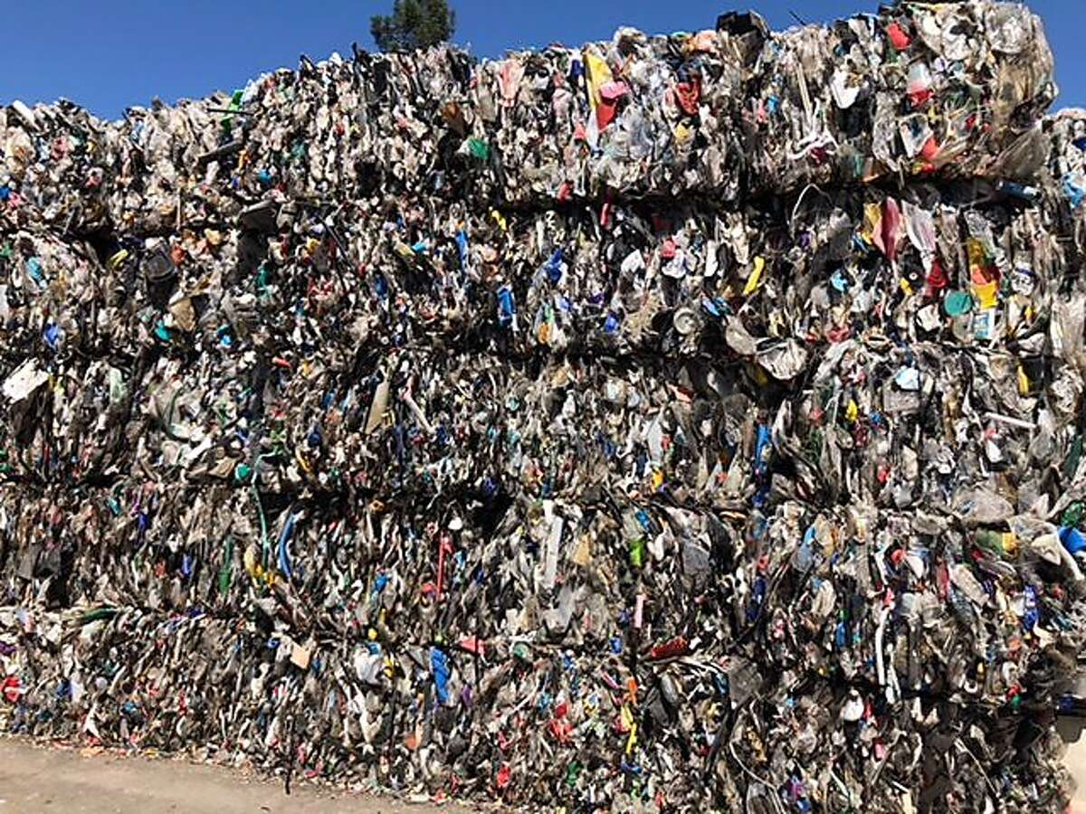 Piles of certain types of plastic, including yogurt cups and cottage cheese containers, sit at Upper Valley Disposal and Recycling, as recycling businesses are waiting for buyers of its materials as China restricts the types of trash it accepts.