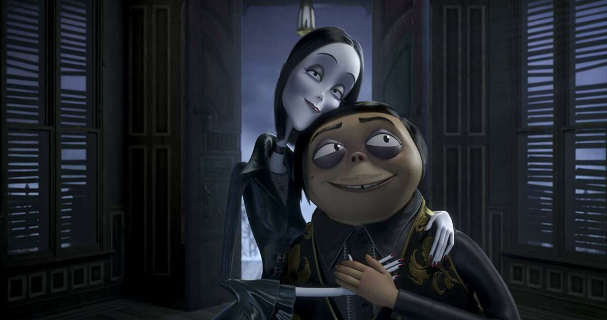 """Charlize Theron and Oscar Isaac provide the voices of Gomez and Morticia in """"The Addams Family'"""