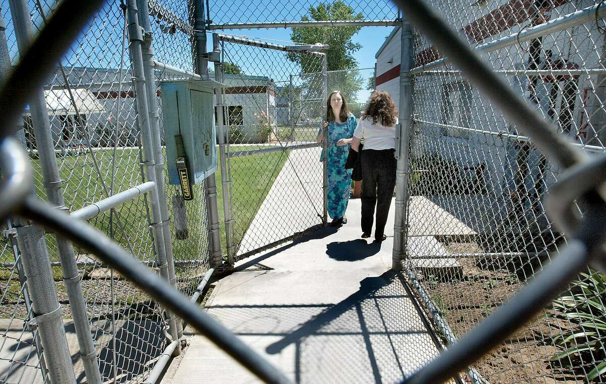 PRISON2-C-12JUN02-MT-MAC Prison Director Susan HIckey opens the front gate for a guard coming on duty. Gov. Gray Davis has changed his mind about closing California's only minimum-security prison for women. The Leo Chesney Center, a private prison in Live Oak was one of five private prisons that Davis proposed closing in his January budget, as a cost-saving move. by Michael Macor/The Chronicle