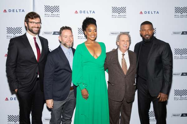 "MILL VALLEY, CALIFORNIA - OCTOBER 03: Writer Andrew Lanham, producer Asher Goldstein, actress Karan Kendrick, festival director Mark Fishkin and actor Jamie Foxx arrive at the opening night premiere of ""Just Mercy"" at 42nd Mill Valley Film Festival at The Outdoor Art Club on October 03, 2019 in Mill Valley, California. (Photo by Miikka Skaffari/Getty Images)"