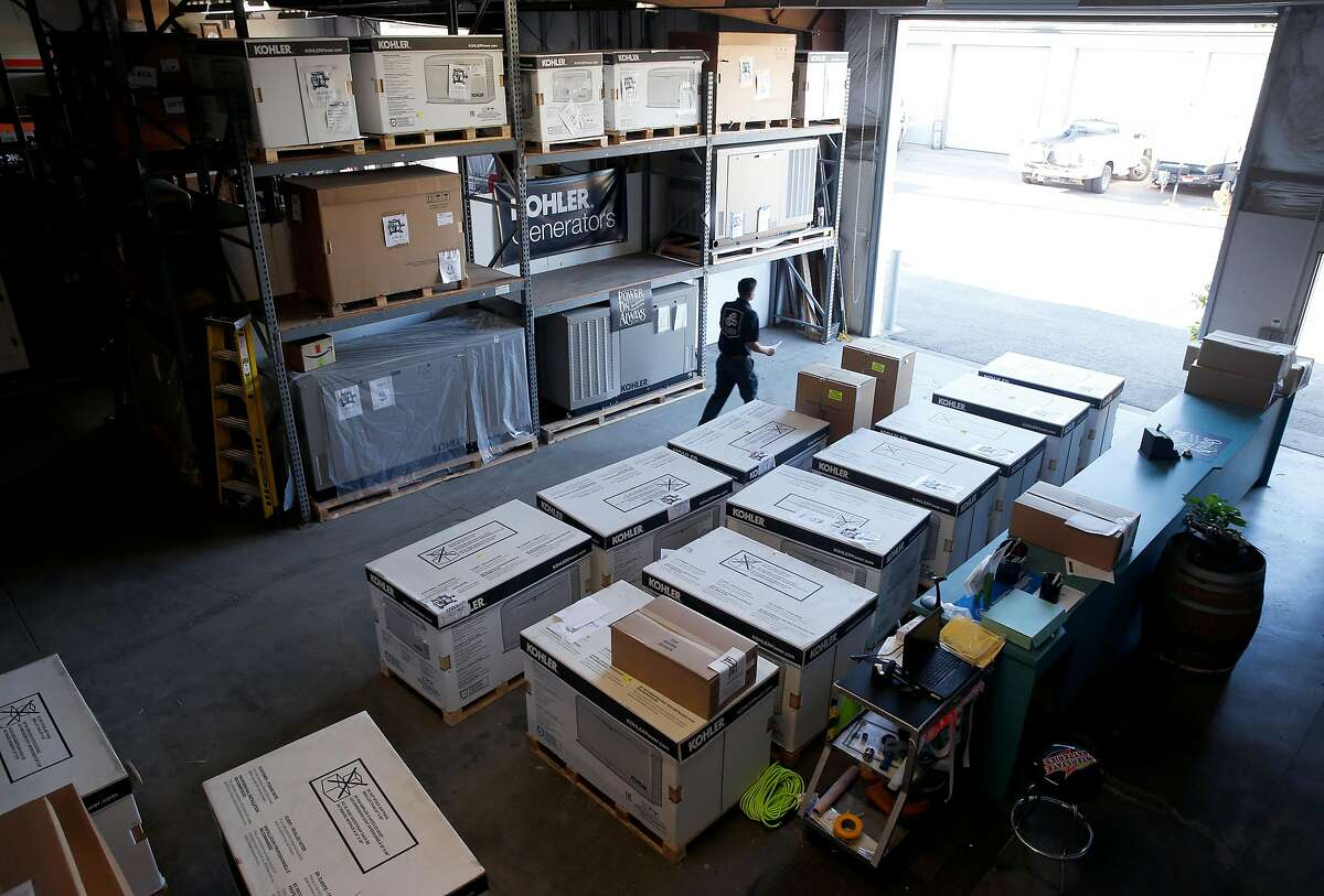 Service technician Leo Hurtado walks through the warehouse filled with generators at Leete Generators in Santa Rosa, Calif. on Wednesday, June 26, 2019.