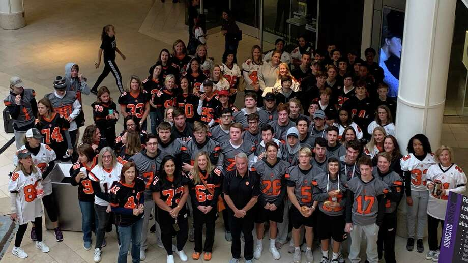 """The Ridgefield High School football team took part in the Women Center of Danbury's fourth annual Safe Walk at the Danbury Fair Mall on Sunday, Oct. 6. The Safe Walk is the center's premier event to unite the community in its mission to end domestic violence and raise much needed funds to support programs. """"A shoutout to our football team for taking part in the Women's Center of Danbury Safewalk #biggerthanthegame"""" tweeted Ridgefield Athletic Director Dane Street. Photo: Twitter / Contributed Photo"""