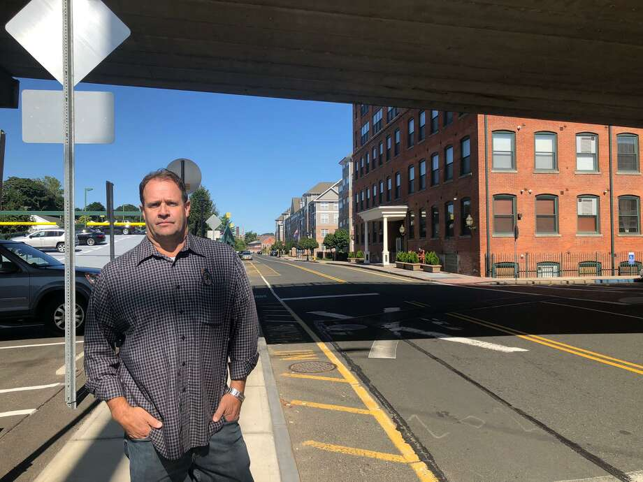 David Eldridge, a Shelton police officer now running for the Planning & Zoning Commission as an Independent, stands along the ever-developing Canal Street. Photo: Brian Gioiele / Hearst Connecticut Media / Connecticut Post