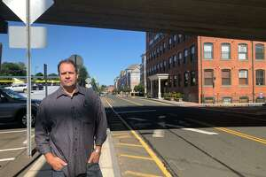 David Eldridge, a Shelton police officer now running for the Planning & Zoning Commission as an Independent, stands along the ever-developing Canal Street.
