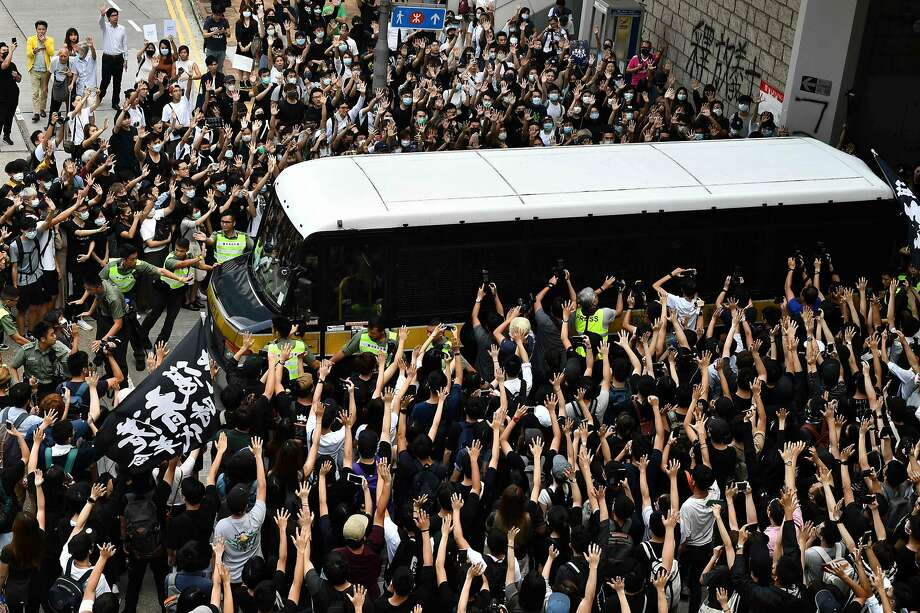 Demonstrators in Hong Kong surround a prison services bus transporting leading independence activist Edward Leung. Photo: Anthony Wallace / AFP Via Getty Images