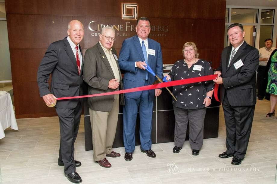 CironeFriedberg celebrated the opening of its new Shelton location with a ribbon-cutting ceremony and a charitable donation to the Boys & Girls Club of Lower Naugatuck Valley. Photo: Contributed Photo / Connecticut Post