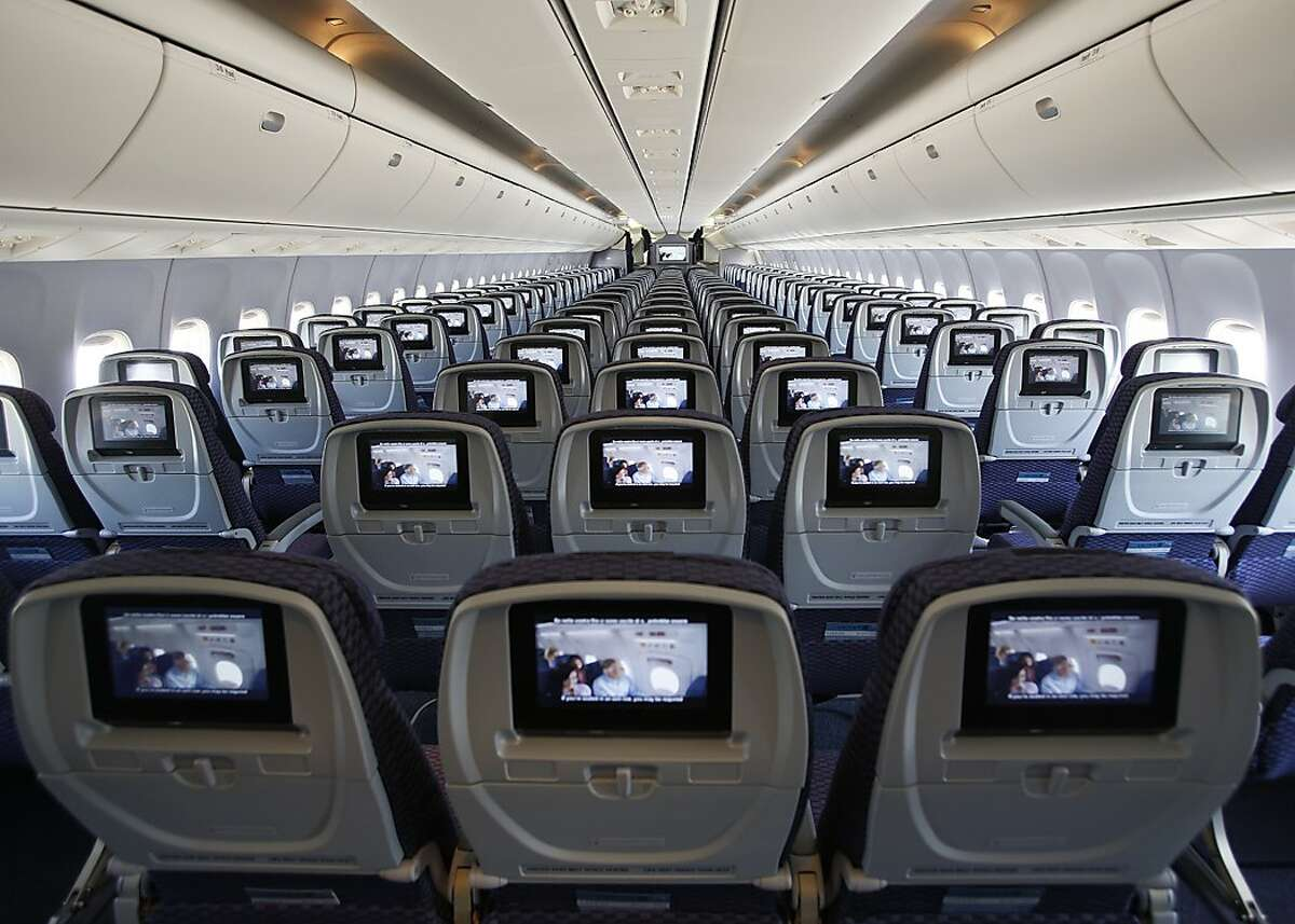 This is a reconfigured Economy cabin in a Boeing 767-300 aircraft, originally from the United fleet. We have completed two of 14 aircraft getting this particular retrofit. With this reconfiguration, every seat has personal, on-demand entertainment. There are power ports at every row, and the overhead bins are larger. Previously, the aircraft had smaller bins, no power ports, and the movies played from screens mounted to the ceilings.