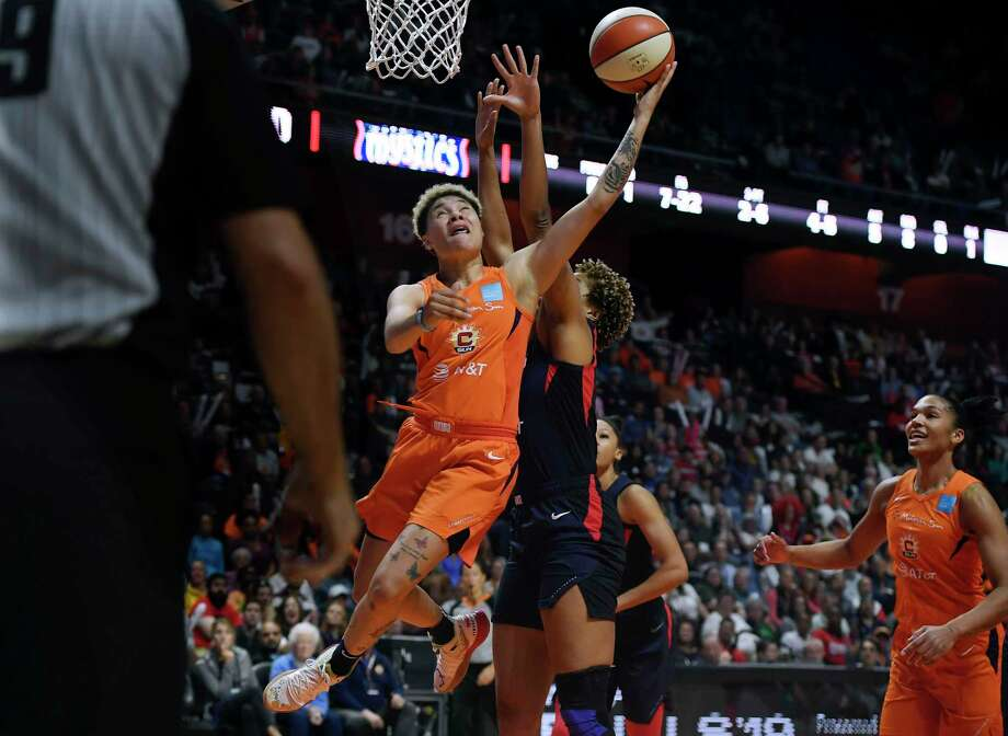 Connecticut Sun's Natisha Hiedeman drives to the basket against Washington Mystics' Tianna Hawkins, rear, during the first half in Game 4 of basketball's WNBA Finals, Tuesday, Oct. 8, 2019, in Uncasville, Conn. Photo: Jessica Hill, AP / Copyright 2019 The Associated Press. All rights reserved