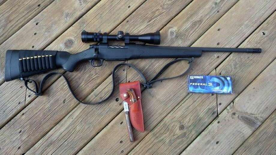Tom Lounsbury is really looking forward to using his new Mossberg rifle and Federal ammo combination for local deer hunting and putting his favorite field dressing kit, a (Made in Michigan) Rapid River Knifeworks knife and Redi-Axe, to work. (Tom Lounsbury/Hearst Michigan)