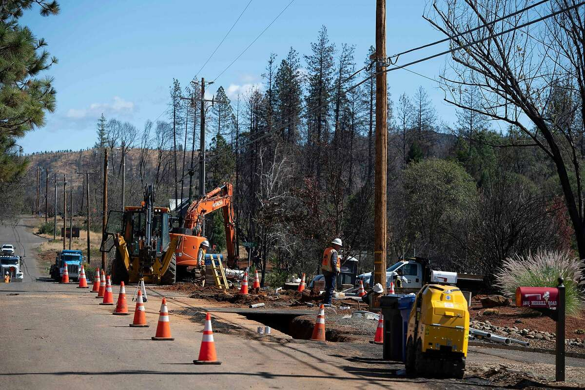 Pacific Gas & Electric Co. (PG&E) workers install conduit in trenches for underground electric lines in Paradise, California, October 1, 2019. - Rolling blackouts set to affect millions of Californians began as a utility company started switching off power to an unprecedented number of households in the face of windy weather that raises the risk of wildfires. Pacific Gas & Electric, which announced the deliberate outage, is working to prevent a repeat of a catastrophe last November in which faulty power lines it owned were determined to have sparked California's deadliest wildfire in modern history.