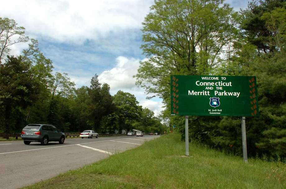 Motorists cruise along the scenic Merritt Parkway as it enters Connecticut in Greenwich. Photo: File Photo / Wilton Bulletin