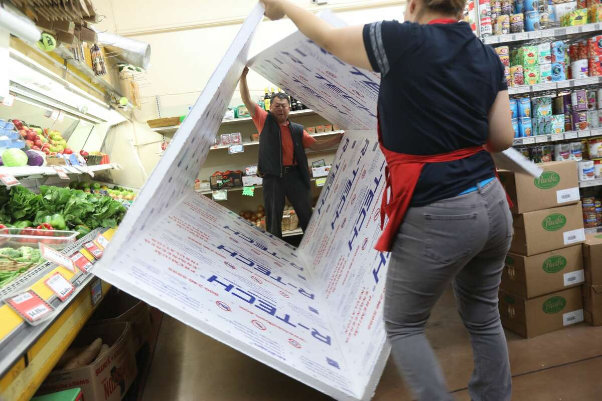 Bob Kim, the owner of Young's Market in Kensington makes a insulated cooler to put his frozen groceries in before losing power in preparation for planned PG&E power shutoffs in Oakland, Calif. on Wednesday, Oct. 9, 2019. He said he would lose 1,000s of dollars of frozen goods without the cooler,