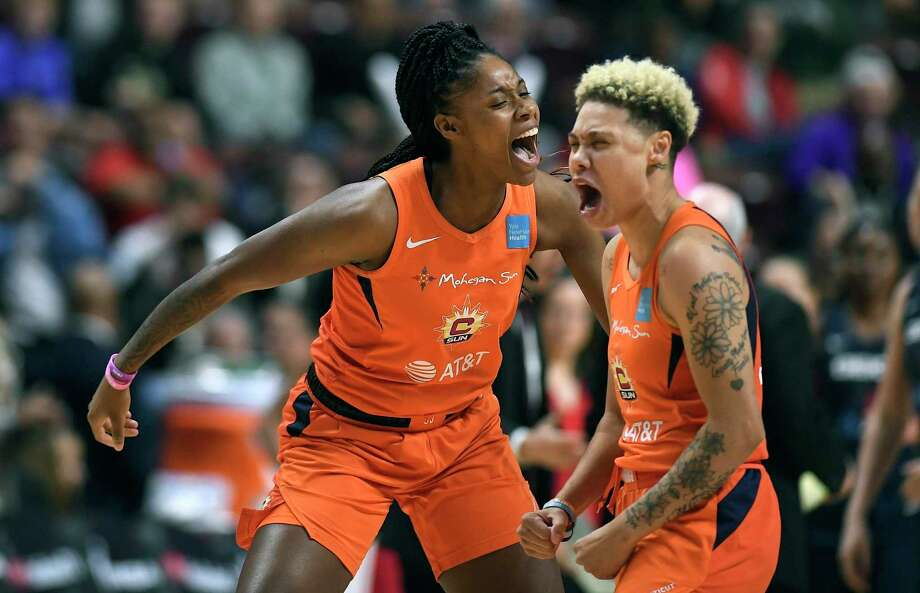 The Connecticut Sun's Bria Holmes, left, and Natisha Hiedeman celebrate a basket against the Washington Mystics during the first half in Game 4 of the WNBA Finals in October. Photo: Jessica Hill / Associated Press / Copyright 2019 The Associated Press. All rights reserved