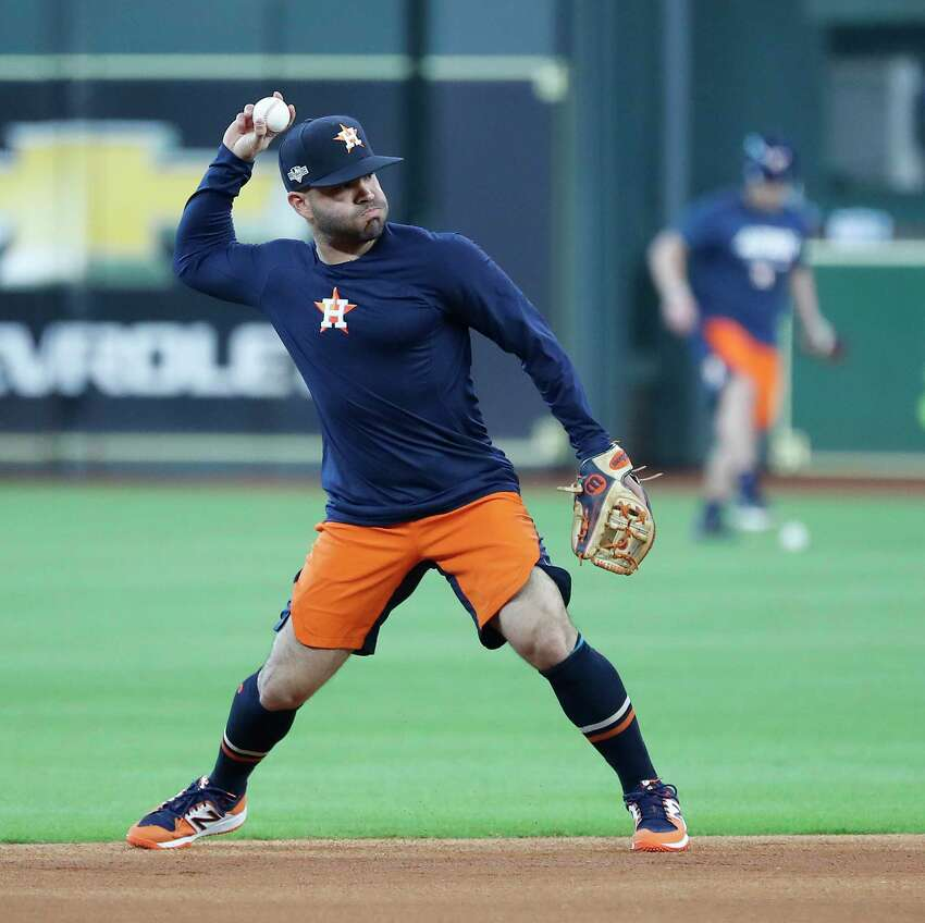 Houston Astros Jose Altuve fields ground balls during optional workouts at Minute Maid Park, Wednesday, Oct. 9, 2019, in Houston.